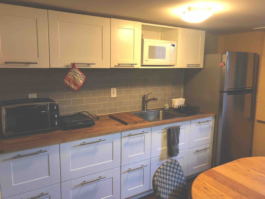 A fully stocked kitchenette will help you to cook breakfast, or full meals, while you're here. Amenities include a full sized fridge, microwave, large toaster oven, induction hot plate, sink, dishes, silverware, cups, pots and pans, basic spices, etc