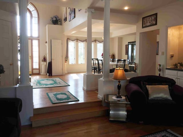 Shot of foyer, dining room and part of living room