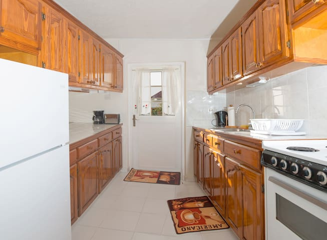 Kitchen equipped with stove,fridge, microwave, andCoffeeMaker