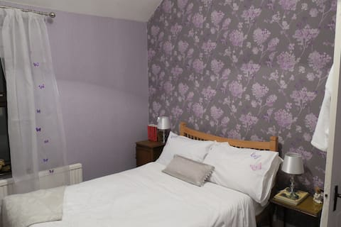 Cosy double bed in the Purple bedroom