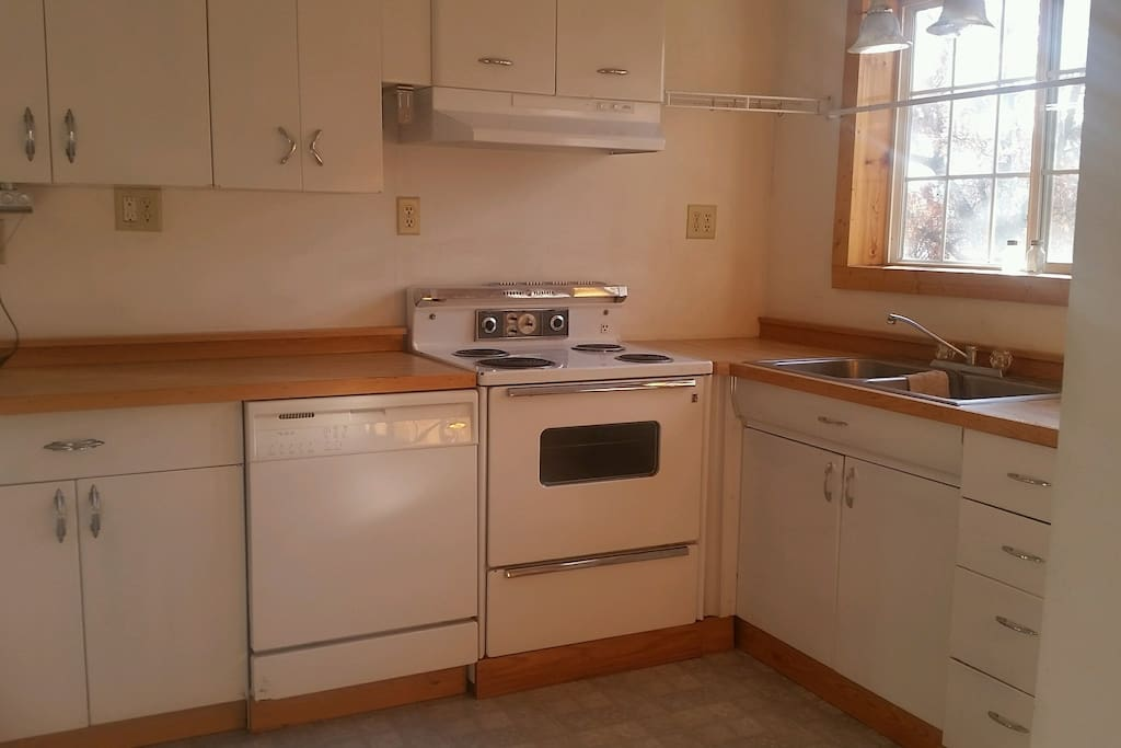Stainless Steel double sided sink, electric range, dishwasher.