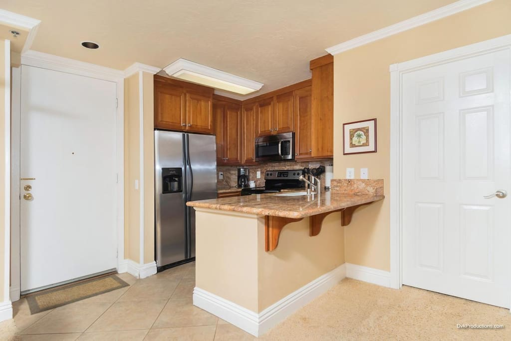 Gourmet kitchen with all appliances, serving ware, plates etc.