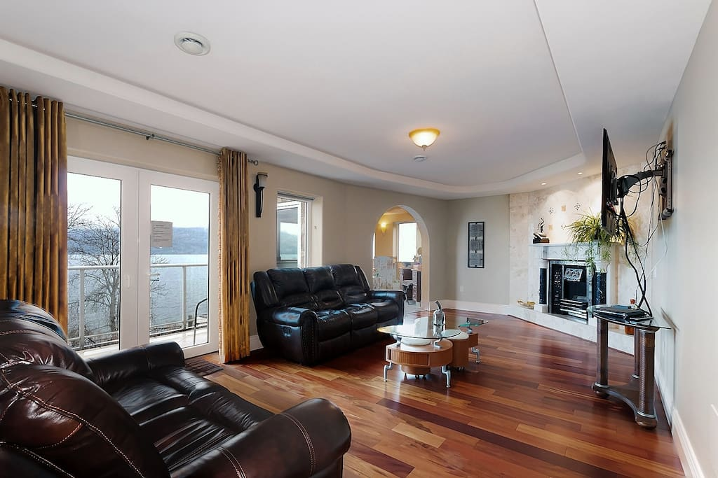 Presidential Master Bedroom sitting area , french door let to private lake view balcony.