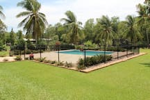 The inviting saltwater pool. Fully fenced with a lock for peace of mind with the kids