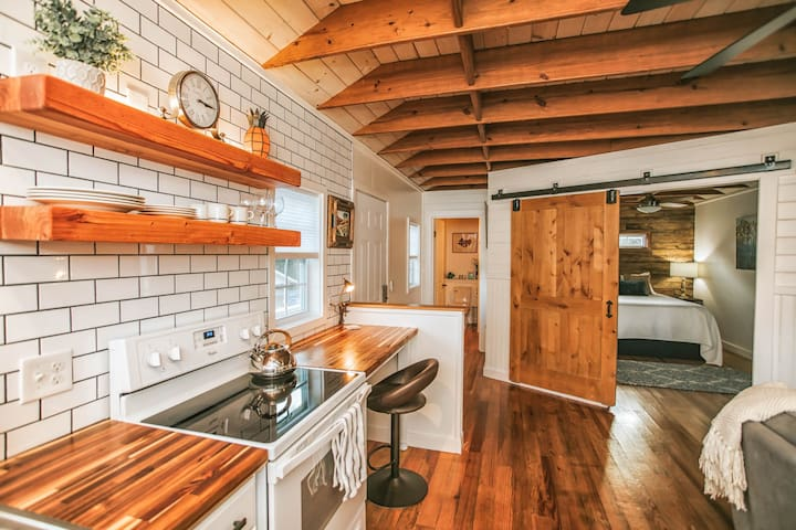 Custom Everything! Sliding barn door, shiplap walls, butcher-block counters, exposed ceiling joists, and lots of other creative details.