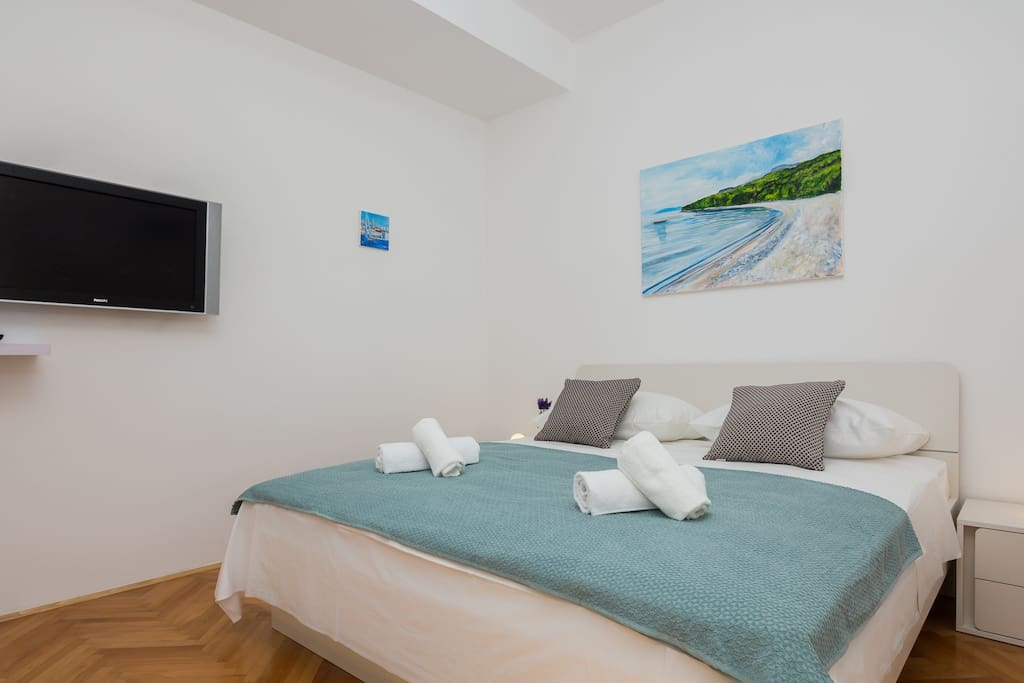 Double bedroom with TV and amazing original paintings of Croatian artist