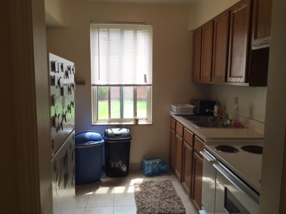 Great kitchen with microwave, coffee maker, fridge, oven, and stove