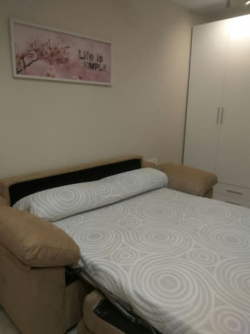 Sofa-cama convertible en cama de 1,50.
