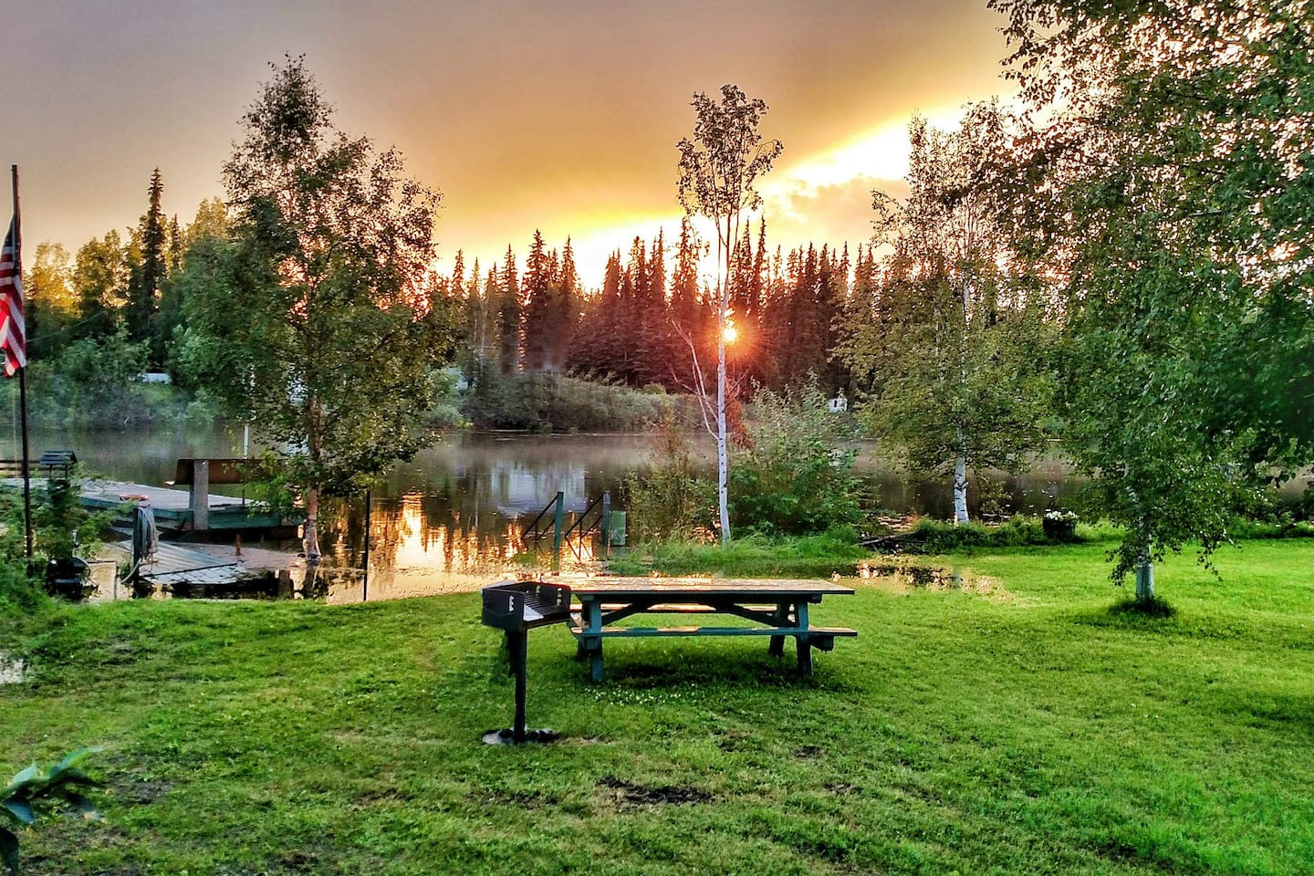 """Our property borders the Chena River. Photo """"Midnight Sun"""" by guest Phillip Collazo, July 2016."""