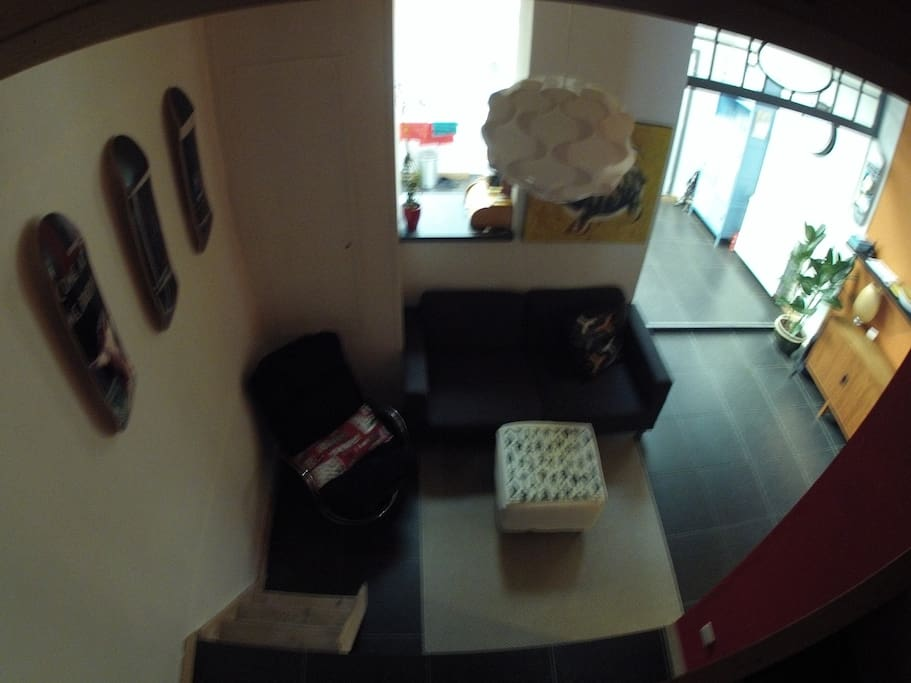 TV room , space for four . A x -box is present , not that you 'll need it with all the nice cafes in the neighborhood.