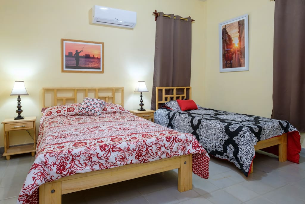 Large air-conditioned room with one double bed and one personal bed, closets to store your belongings, safe, TV and a second minifridge always stocked with beer,water and soft drinks