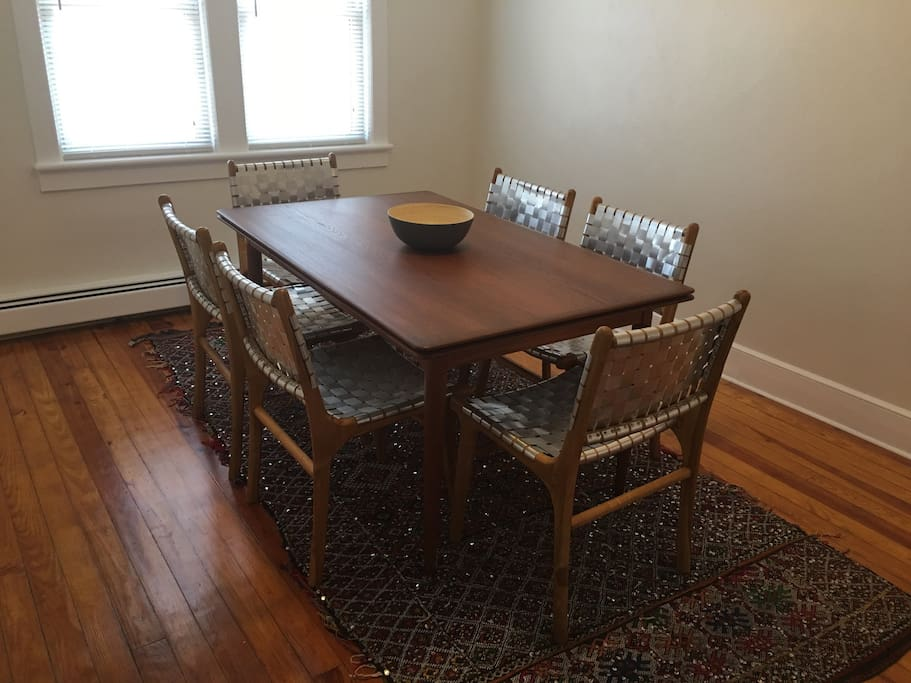 Dining room with a Danish teak table and Moroccan rug.