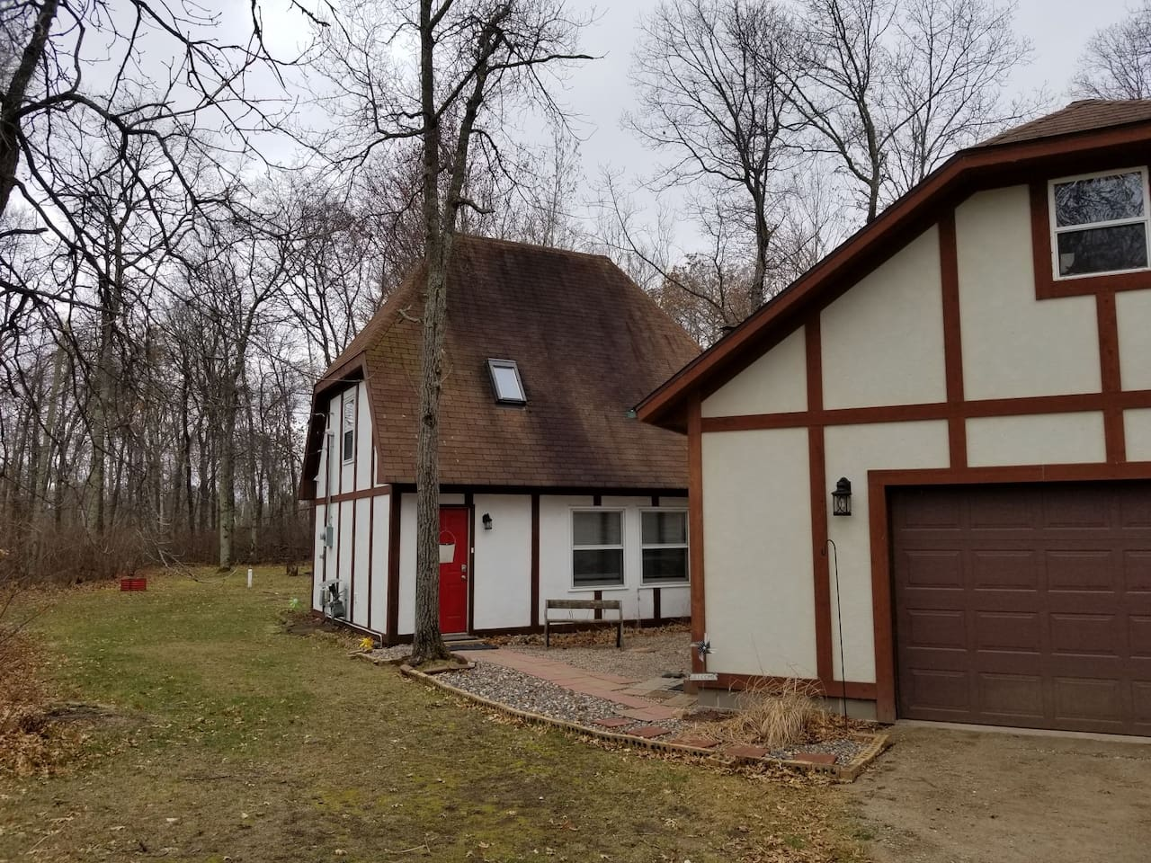 It looks like Hansel and Gretel live here in the forest!  Charming house and nicely updated for up to 6 guests.  Bedrooms are on second floor. King bedroom and twin beds in second.  2 can sleep on main floor queen sleeper.