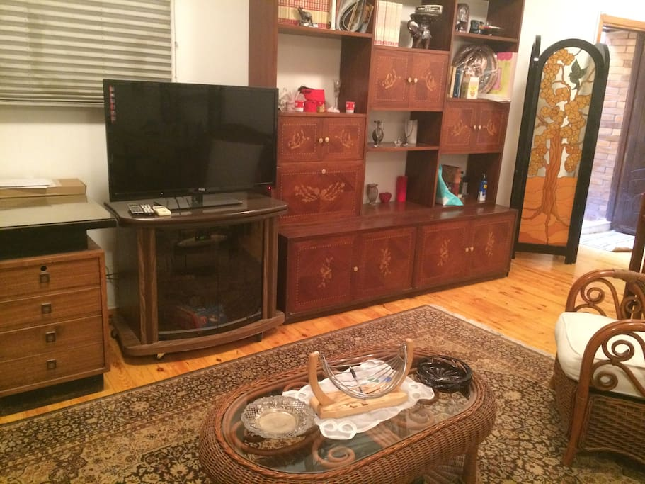 Desk + LED TV with satellite and sitting couch & chairs