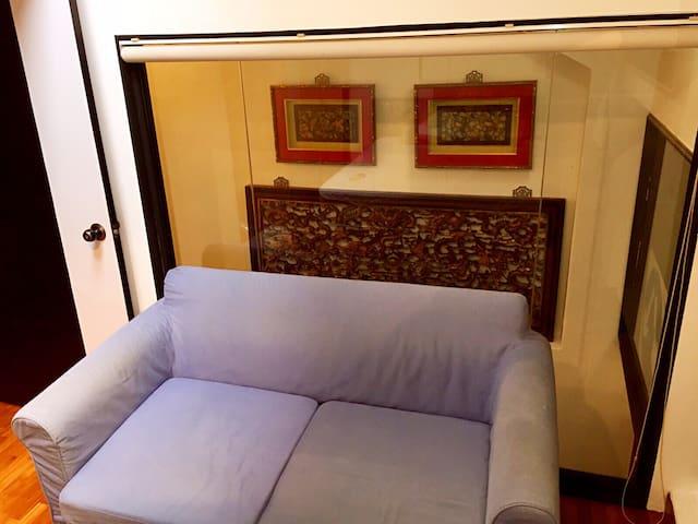 Sofa bed where desk was. Looking toward top of stairway