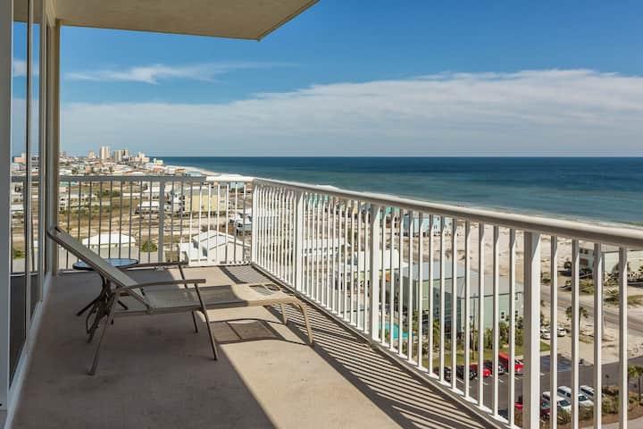 Beach view condo w/ outdoor community pool, sauna, & fitness center!