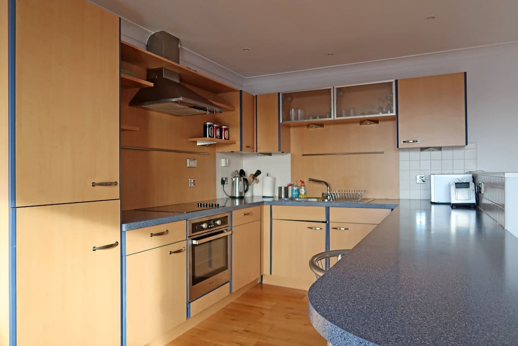 Open plan, fully fitted kitchen