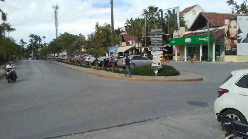 Plaza turquesa on the right, restaurants, grocery and pharmacy, my street is the next one, directly after this