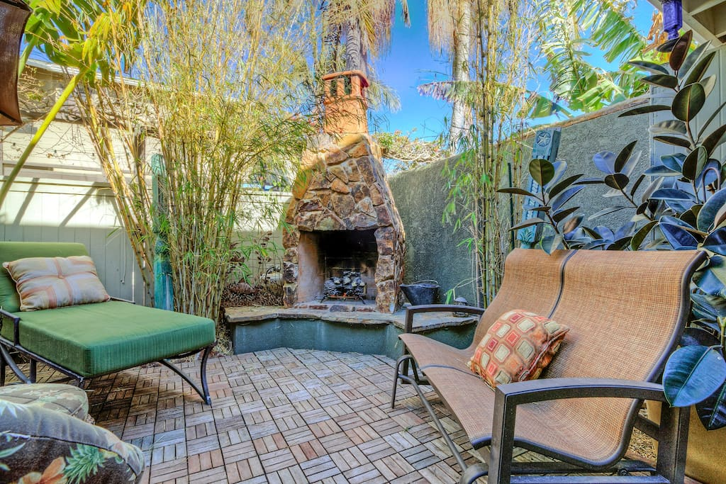 Outdoor seating sits around the built in fireplace