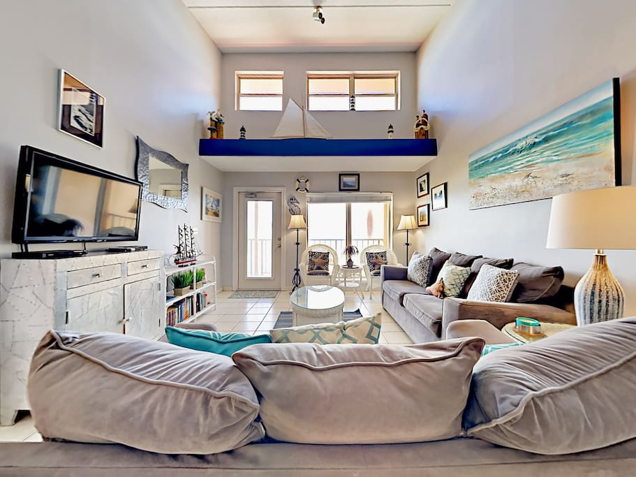 Enjoy lots of natural light in the beach-inspired living room.