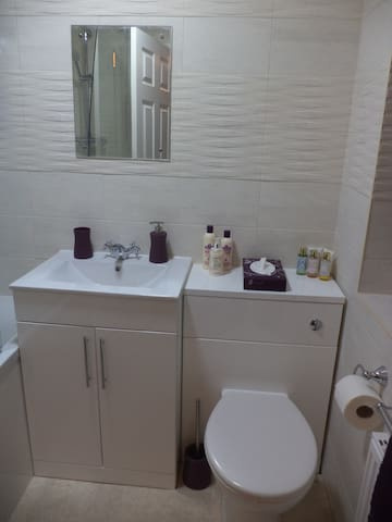 Guest bathroom with new suite. Toiletries and towels provided. First aid kit in cupboard.