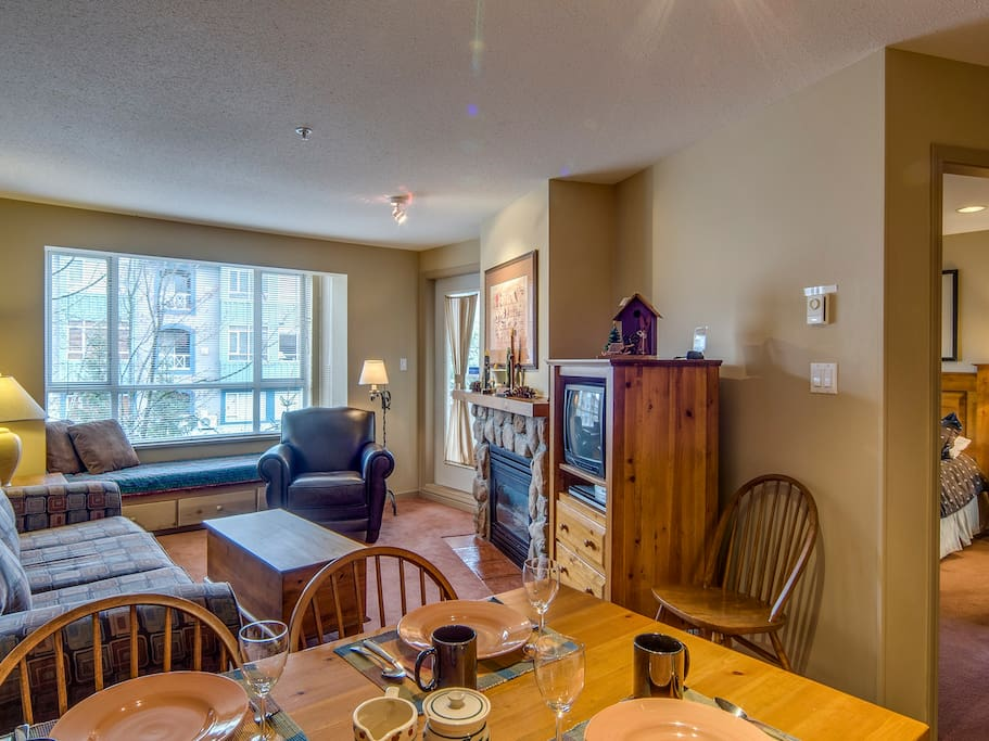 Dining area with comfortable living space. Note: Single windowbed for sleeping or people watching on famous Whistler village stroll!