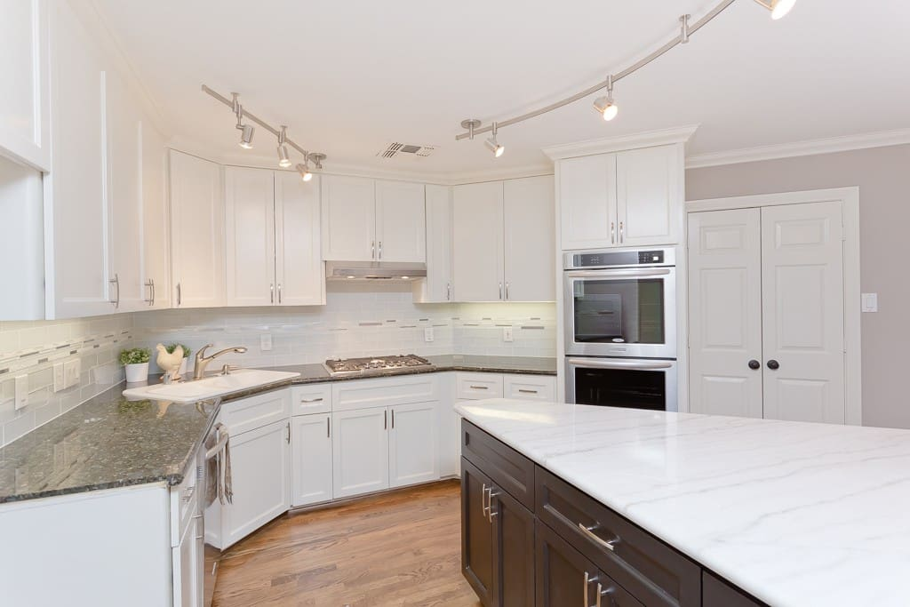 Carerra marble and granite countertops.  Brand new appliances and French door refrigerator.