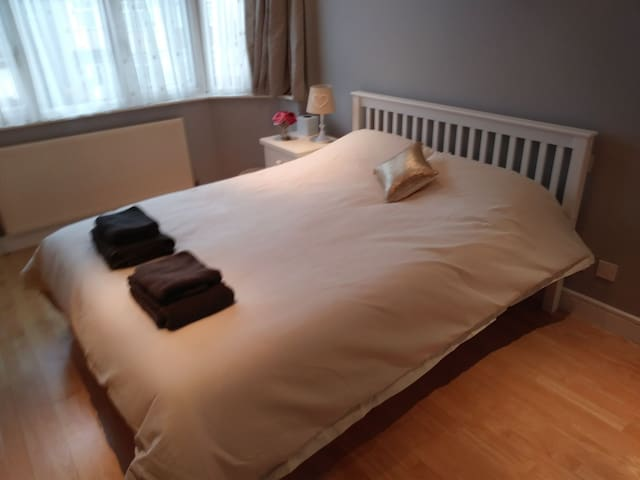 Double bed in lovely home