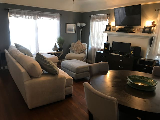 Comfy living room with TV and dining table