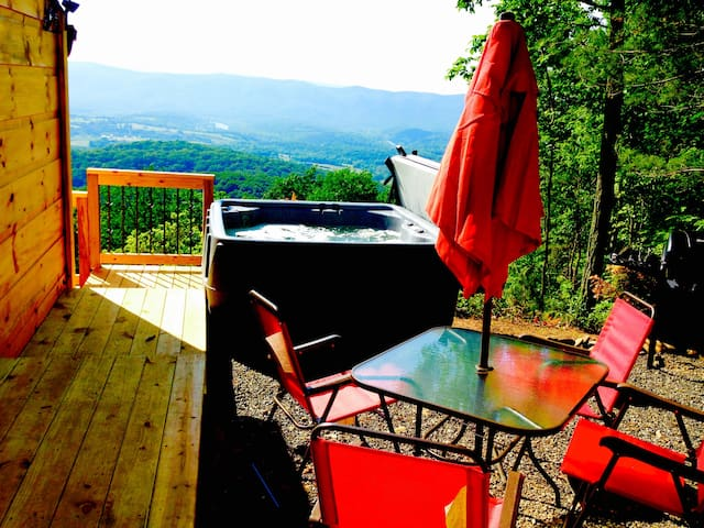 Hot tub, chairs, table & grill...all you need for a relaxing day outside