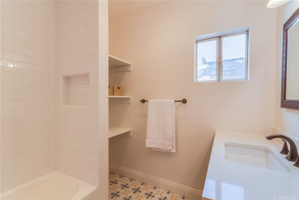 Your bathroom is located right next to your bedroom. No one using this currently.  Brand new fixtures and tiles.