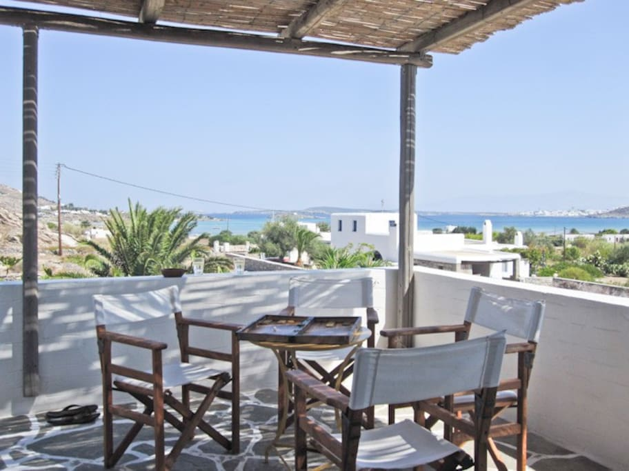 your private veranda ( kolimbithres beach is 7 minutes walk on a quiet country road)