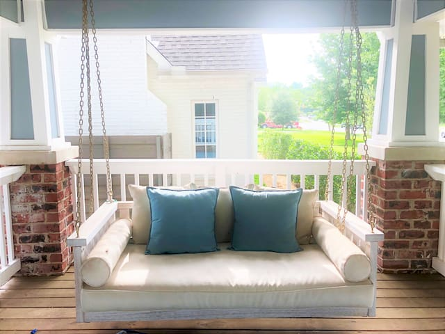 Enjoy your morning coffee on this lovely porch swing!