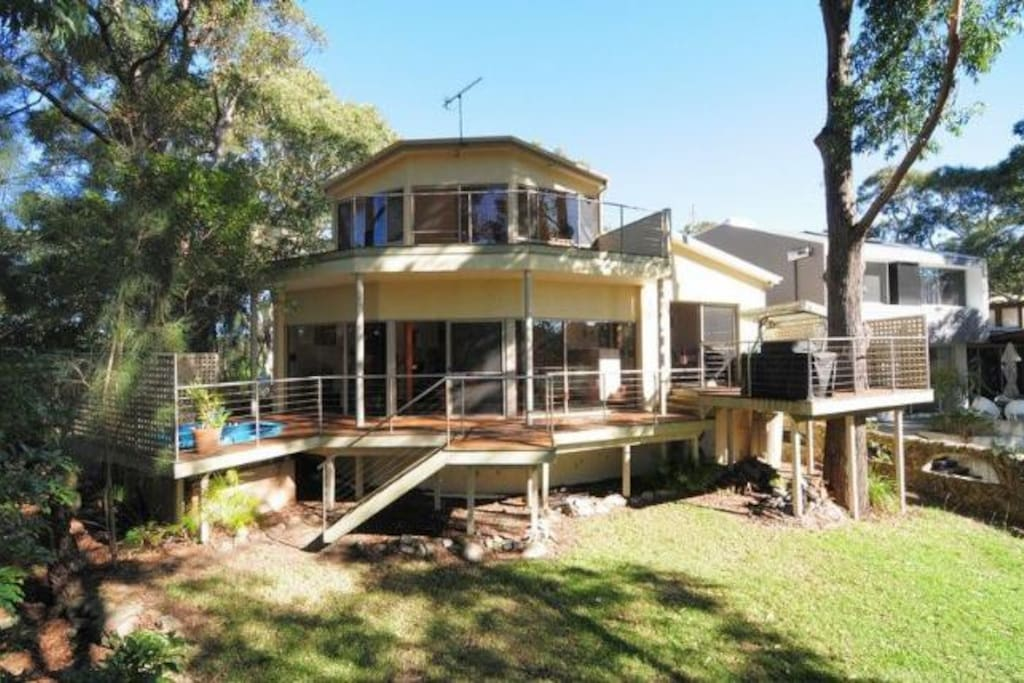 Sit on your wrap around deck, take in the view of the tree tops and listen to the waves and colourful birdlife.