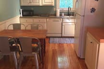 The kitchen is fully equipped with full size stove, microwave and refrigerator,and coffee maker