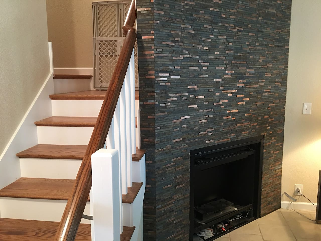 New gas fireplace next to stairs