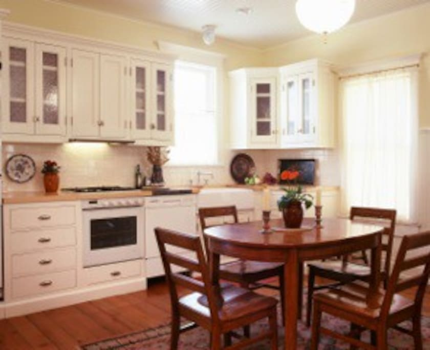 Kitchen has custom milled casework and cabinets to replicate the originals from 1892.