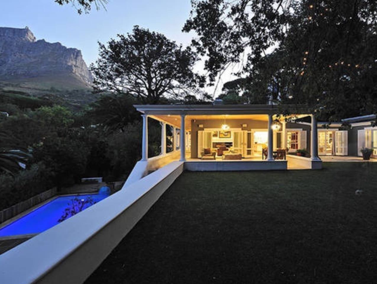 A flat lawn with breathtaking views of iconic Table Mountain and heated pool.