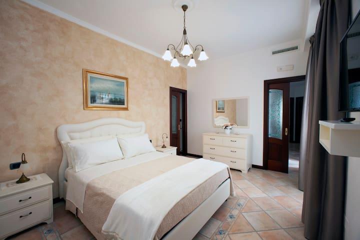 Casa Vacanze - L'ARCO TRA I SENTIERI