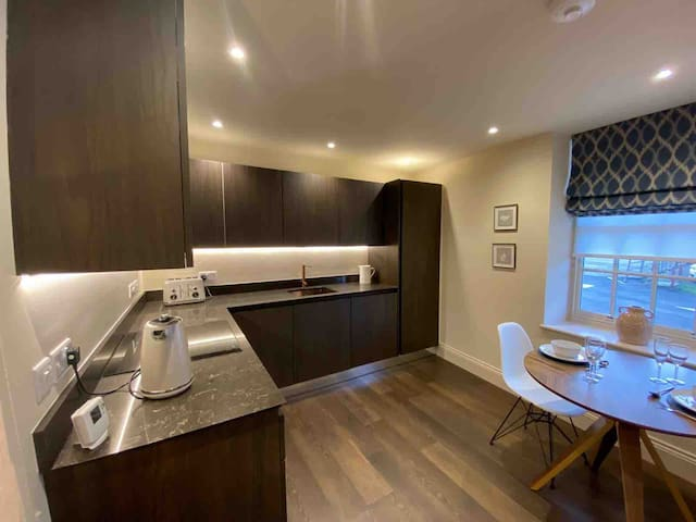 The luxury fitted kitchen and dining area, complete with wine cooler, dishwasher,  fridge freezer, induction hob and oven, toaster and kettle.