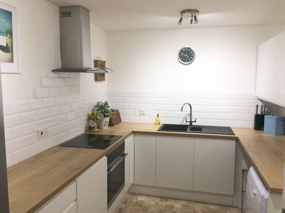 Brand new fitted kitchen, electric hob, over, extractor, dishwasher and washer/dryer. fridge freezer and breakfast bar with bar stools