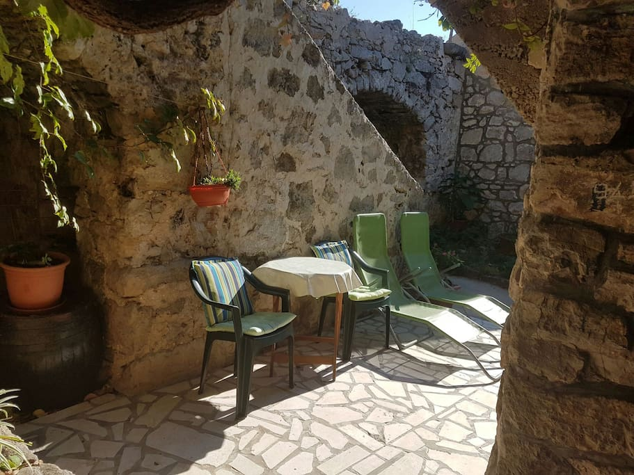 The front yard of the Cave, perfect place for sunbathing even during Winter months considering the fact it's protected from the wind