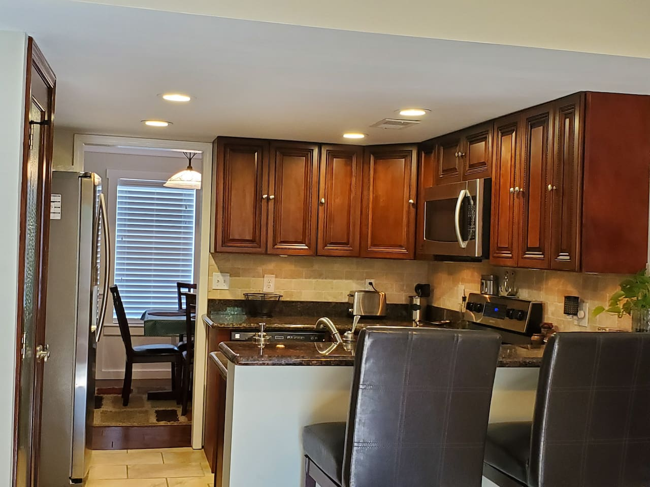 Full kitchen with bare essentials you need to cook meals and keep things refrigerated including a dishwasher, Microwave, and an oven with glass top stove. There is a pantry for storing food also.