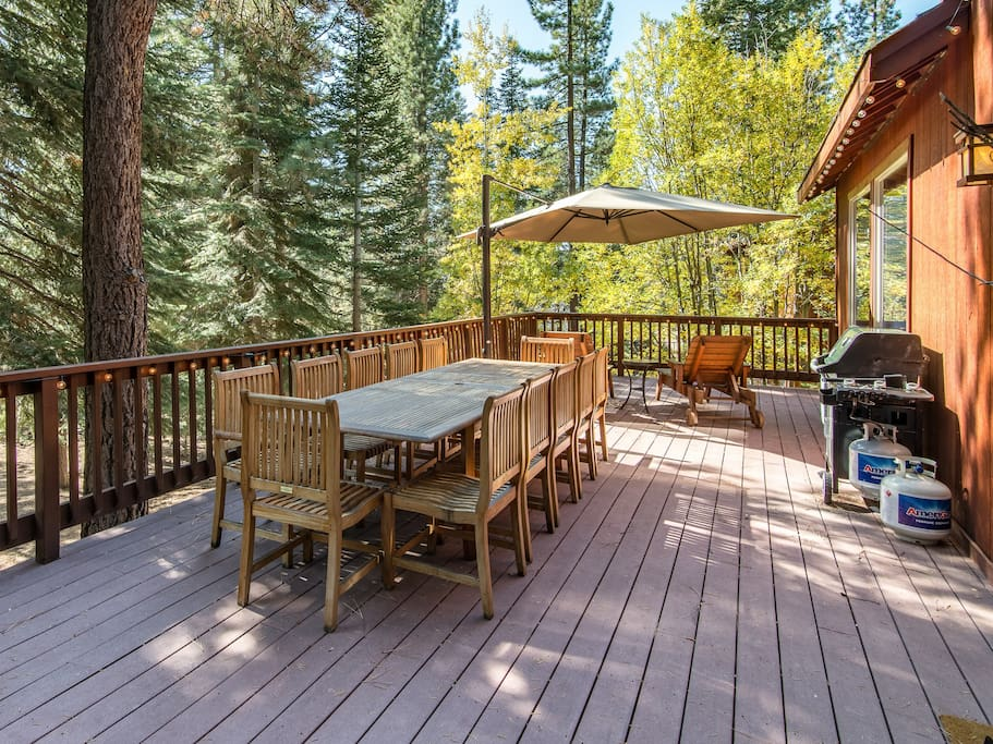 Expansive deck with grill and 12-person dining table.