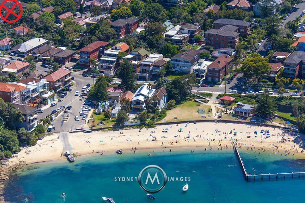 Apartment located at the red X, top left. 200m walk to Little Manly Beach. Popular with locals and hidden away from the main Manly Beach. Its at harbour beach with no waves and an enclosed swim area.
