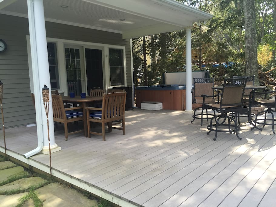 Living room leads out to covered deck and hot tub