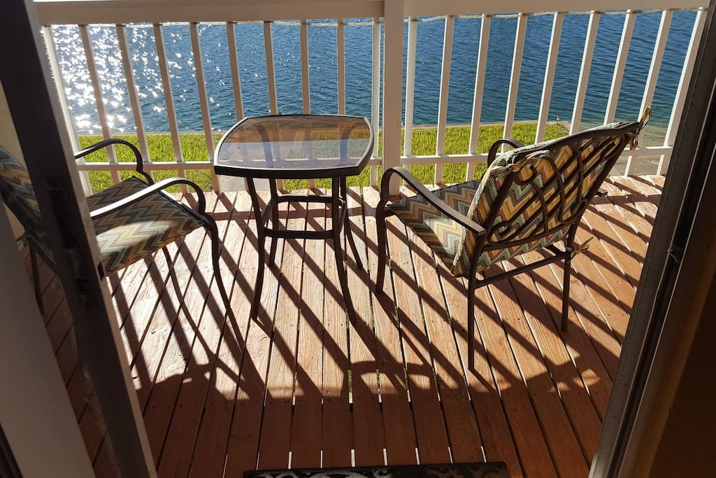 West upstairs back patio over looking wide saltwater canal that has access to the Gulf waters.