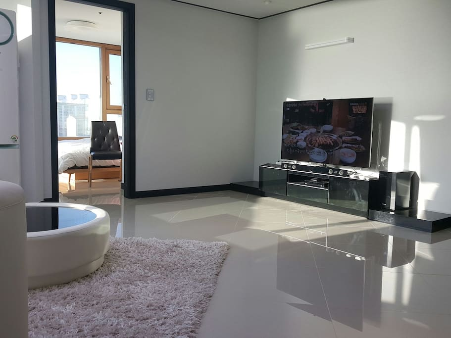 Very bright and warm living room with Multi AV system