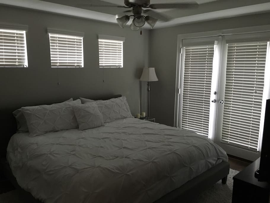 Master Bedroom with King Bed and Patio Access.