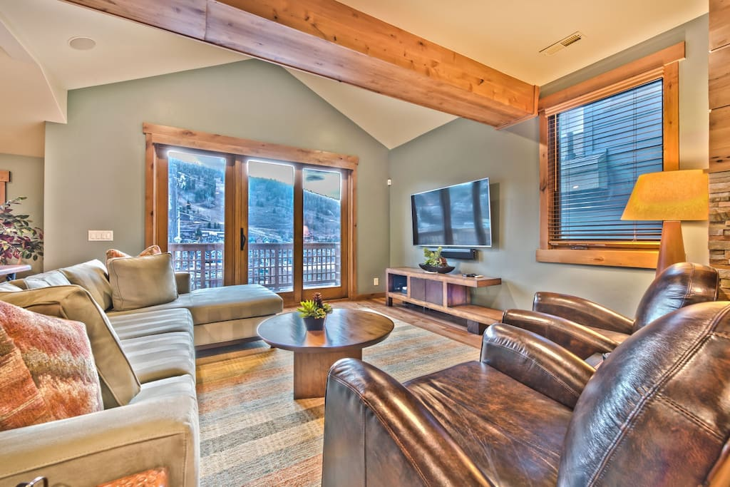 Living Room with Comfortable Mountain Furnishings, TV and Private Deck with Stunning Views!